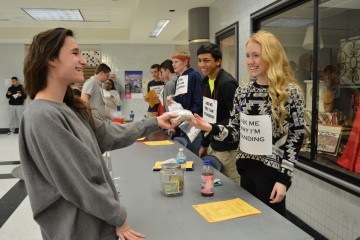 Katelyn Davis, Dance Marathon executive council member and senior, talks to senior Robyn Zoccola about Dance Marathon. Davis said executive council members will be standing in lunches through the week of Jan. 26. SARA YUNG / PHOTO