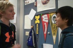 Matt Young, Cabinet member and senior, convinces senior Brian Li to attend a fundraising event for Dance Marathon. According to Assistant Principal Amy Skeens-Benton, members of the Freshman Class look forward to participating in Dance Marathon on Feb. 21. MIRIAM HU / PHOTO